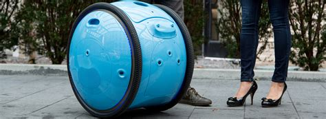 piaggio gita cargo bot carries your things so you go hands